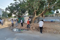 Atmiya students cleaning in the vicinity of university campus.