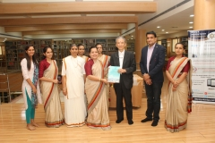 Guest from University of Miyazaki handing over brochure to Dr. Sheetal Tank, Atmiya University librarian.