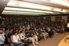 The audience of students mentors and jury listening to Swamiji