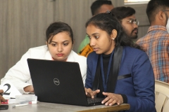 All girls team participants focussing on their problem
